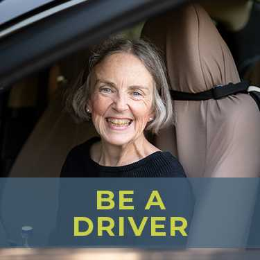 Be a volunteer driver to help aging adults with transportation. Smiling volunteer driver, ready to provide a ride to an aging adult who needs help getting around. She's happy because transportation for seniors is now solved!